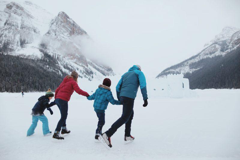 Family skating on Lake Louise, Banff National Park.