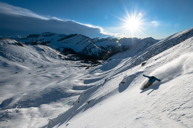 winter scenic shot of snowboarder at Lake Louise Ski Resort