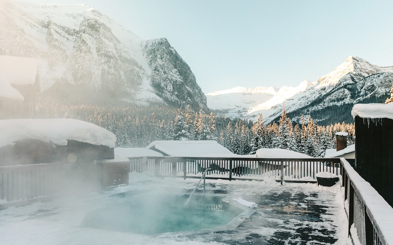 Views of Victoria Glaier, Lake Louise from rooftop hot pool at Deer Lodge.