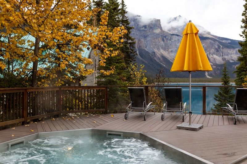 View of Emerald Lake from outdoor hot pool at Emerald Lake Lodge, Yoho National Park.