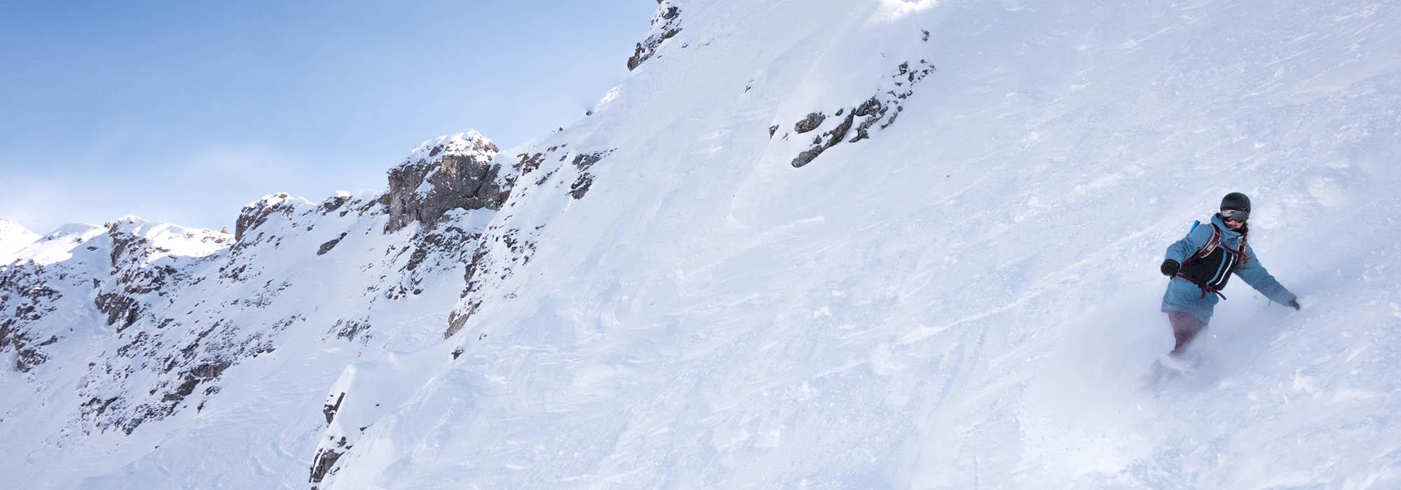 Snowboarder in Delirium Dive at Banff Sunshine Village, Banff National Park.