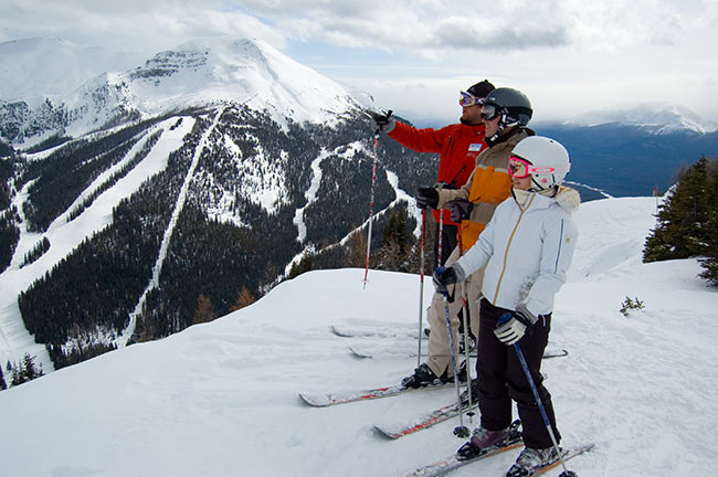 SkiBig3 instructor with guests at Lake Louise
