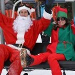 Santas and an elf at the Mt. Norquay Cascade chair.