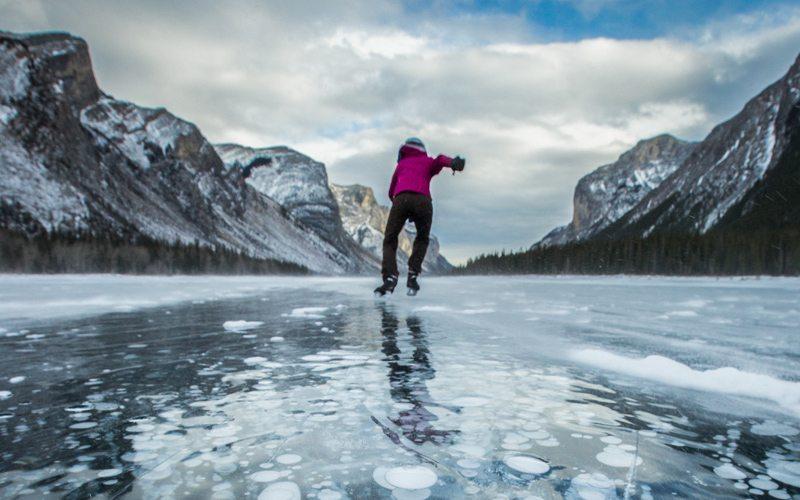 Ice skating at Lake Minnewanka. Image by Paul Zizka.