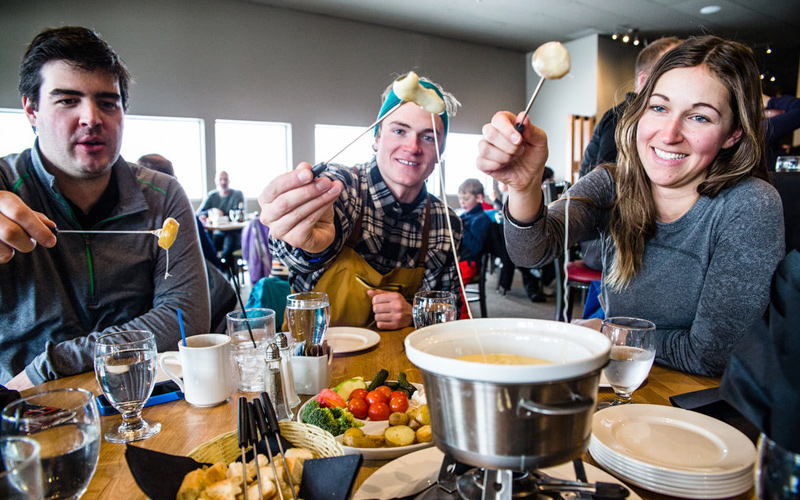You're spoiled for choice with hot meal options at Ski Big 3 resorts, like cheese fondue at Whitehorn Bistro, Lake Louise Ski Resort. Photo: Liam Doran.