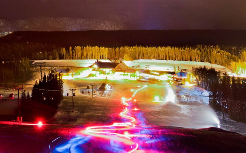 Enjoy the festive glow of an on-mountain Torchlight Parade. Photo: Lake Louise Ski Resort.