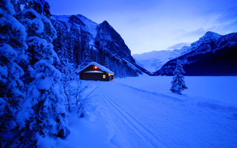 Experience the beauty of Lake Louise after dark with a night owl snowshoe tour. Photo: Canada Alive.