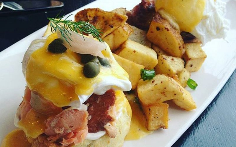 Fuel your ski legs with salmon benny & other delights at Juniper Bistro. Photo: @juniperbanff on Instagram.