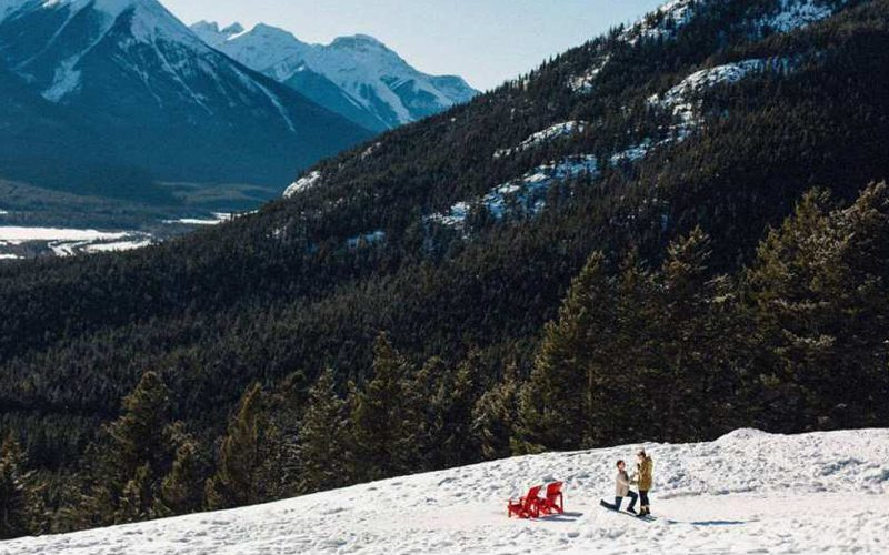 Parks Canada red chairs offer stunning views over Banff on the drive to Mt Norquay. Photo: Diane and Mike Photography/Calgary Herald.
