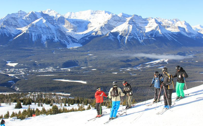 You'll be tearing up the slopes in no time with the help of our Club Ski experts. Photo: Lake Louise Ski Resort.