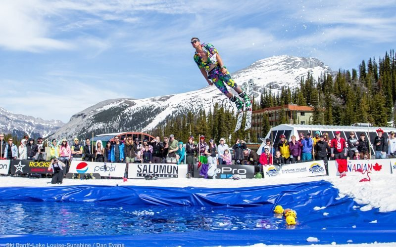 A skier soars through the air before getting dunked at Slush Cup, an annual spring tradition at Sunshine Village.