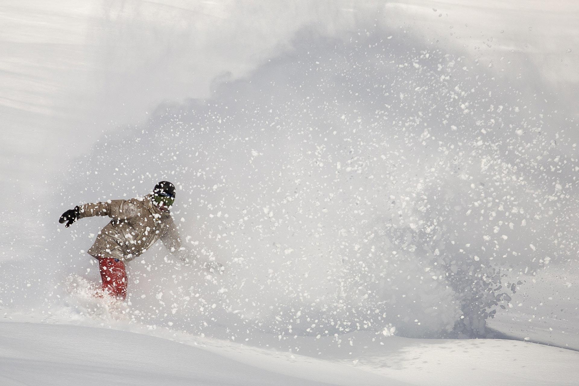 Epic powder shot of a snowboarder at Lake Louise Ski Resort. Photo: Chris Moseley