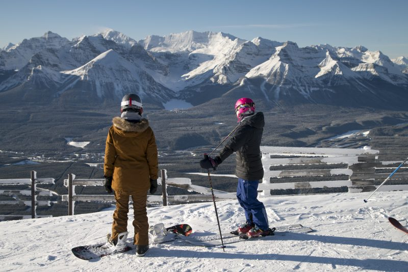 Sasha DiGiulian and Quincy Davis take in the views from the Top of the World chair at Lake Louise Ski Resort. Photo by Dan Evans