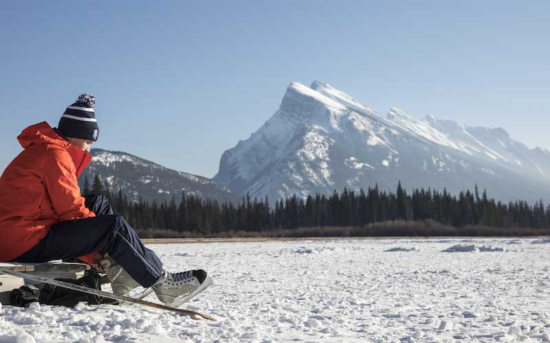 Ice skating on Vermillion Lakes in Banff National Park, Mt. Rundle in the background.