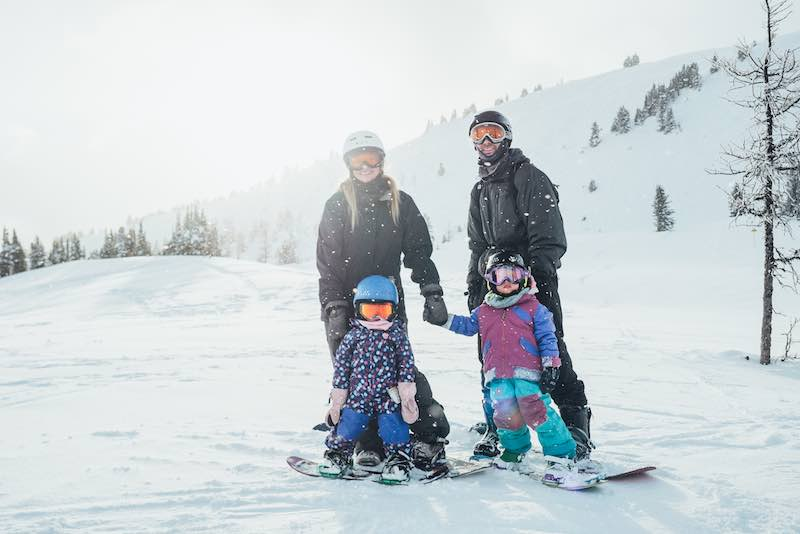 Family snowboarding at Banff Sunshine Village, Banff National Park.
