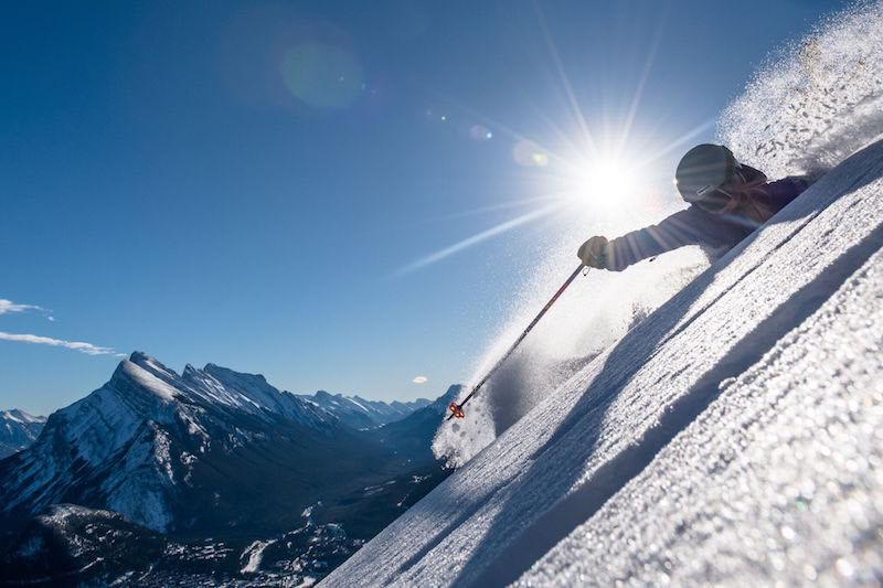 Skier in deep powder at Mt. Norquay