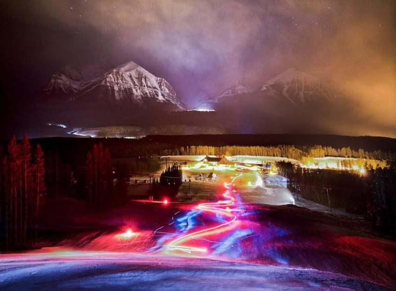 Night photo of Torchlight Dinner event at Lake Louise Ski Resort.