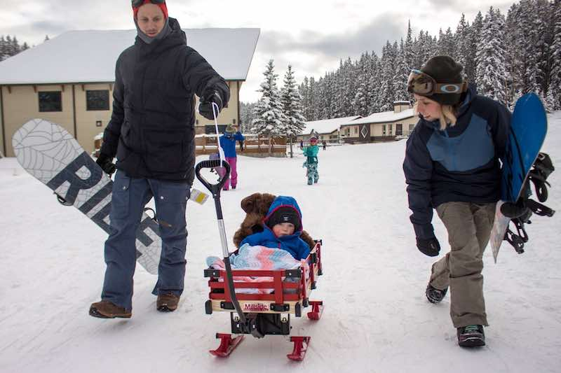A family at Mt. Norquay ski resort, Banff National Park.