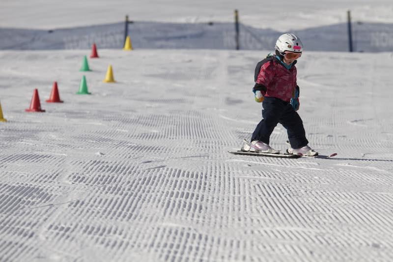 Kid skiing on corduroy at Mt. Norquay