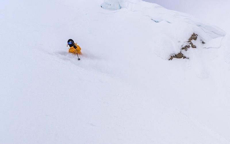 Deep powder skier by Travis Rousseau