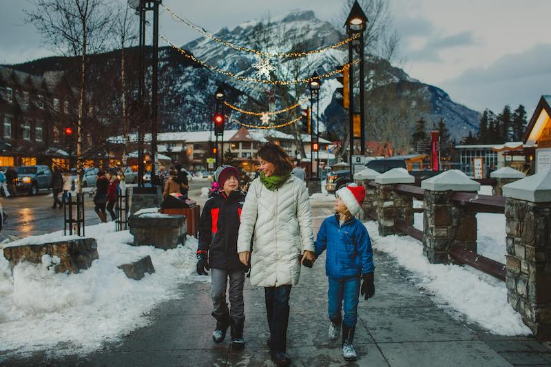 A family takes a winter walk down Banff Avenue.