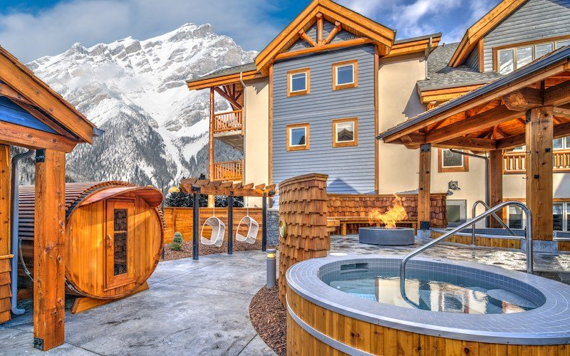 Outdoor hot pools and outdoor sauna with views of Cascade Mountain at CanAlta Lodge, Banff, Alberta.