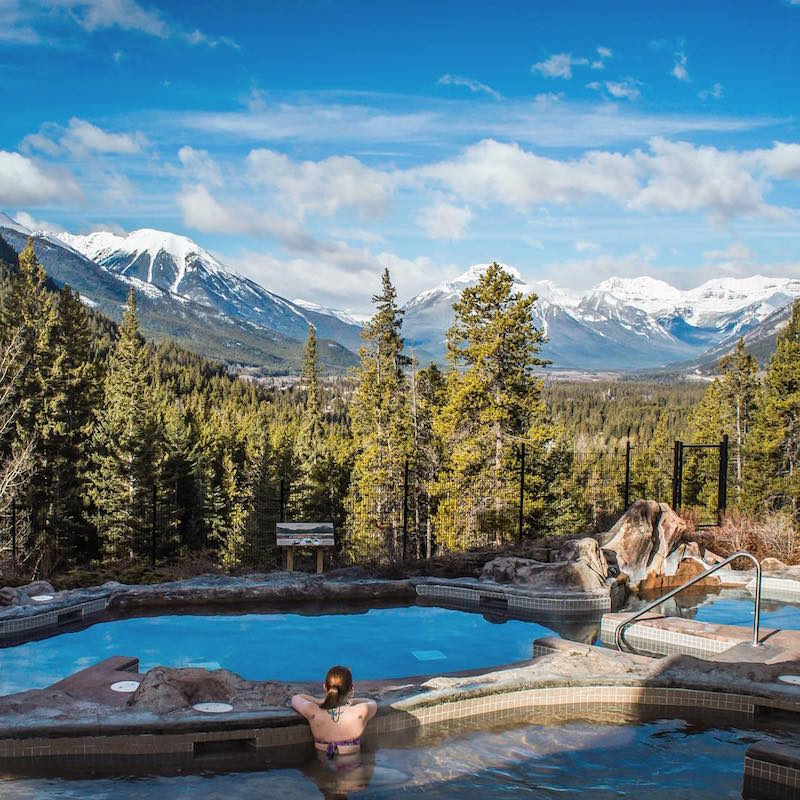 Mountain views from the outdoor hot pool at Hidden Ridge Resort, Banff, Alberta.