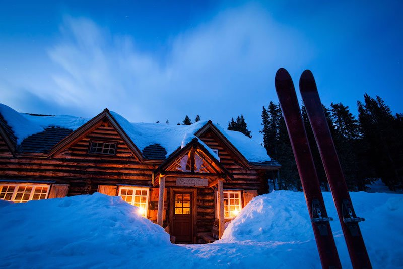 Winter exterior shot of Skoki Lodge, Banff National Park.