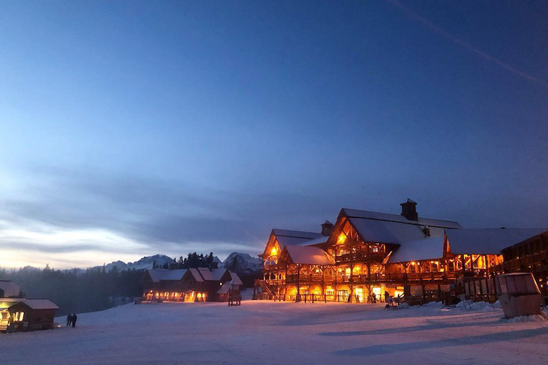Night exterior shot of Whiskey Jack Lodge at Lake Louise Ski Resort, Banff National Park.