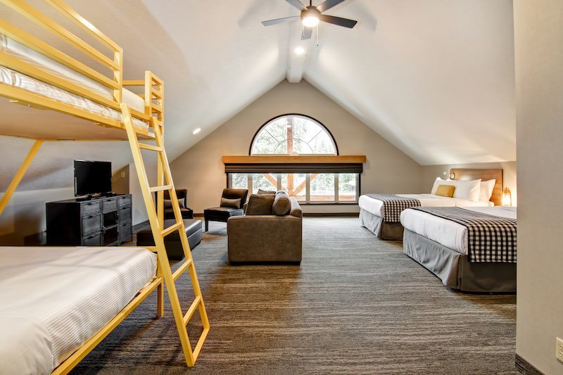 Interior shot of double queen and bunk beds loft suite at CanAlta Lodge, in Banff, Alberta.