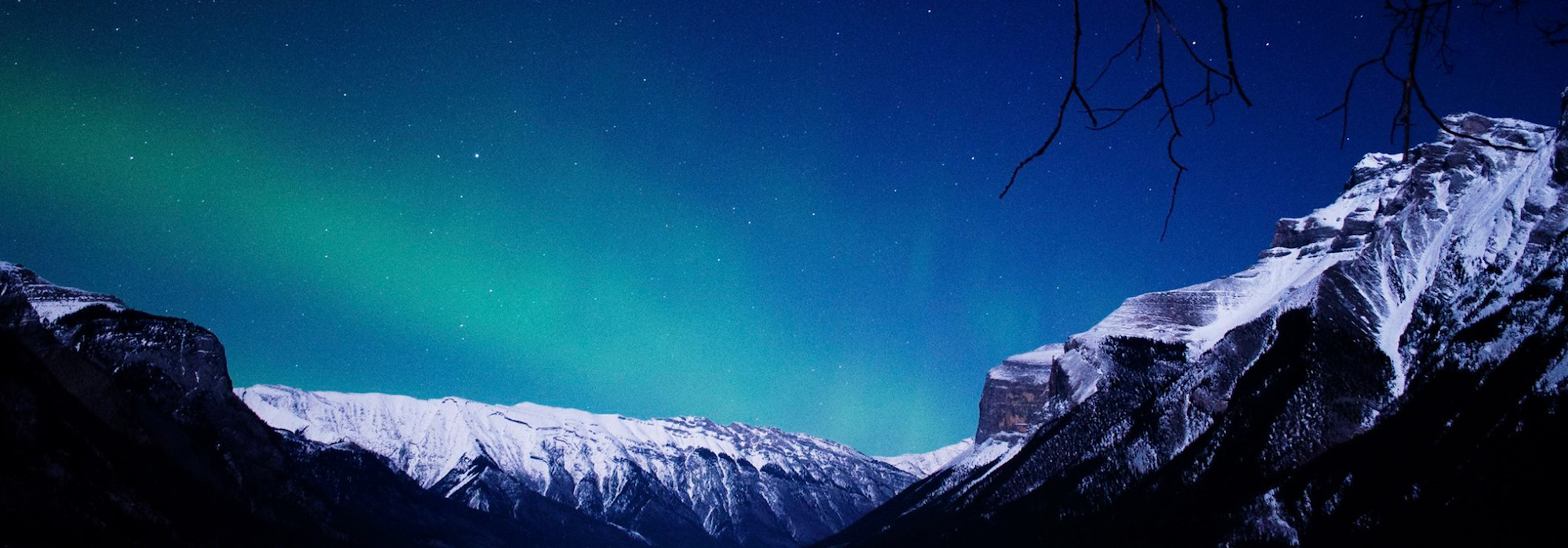 Aurora Borealis above Lake Minnewanka, Banff National Park.