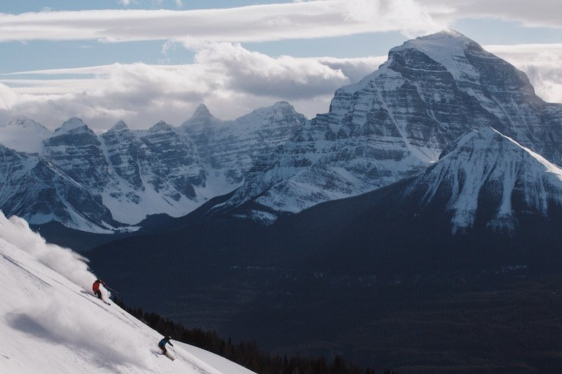 Skiers at Lake Louise Ski Resort, Mt. Temple in background, Banff National Park.