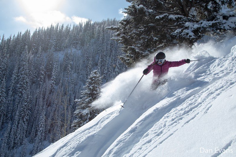 Michelle Brazier skiing fresh powder in Sun Chutes at Mt. Norquay ski resort, Banff National Park.