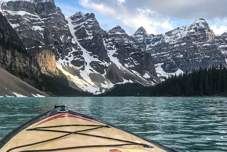 Stand-up paddleboarding on Moraine Lake, Banff National Park.