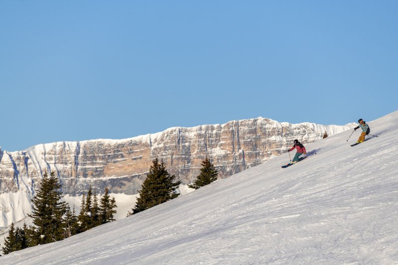 Two skiers at Lake Louise Ski Resort, Banff National Park.