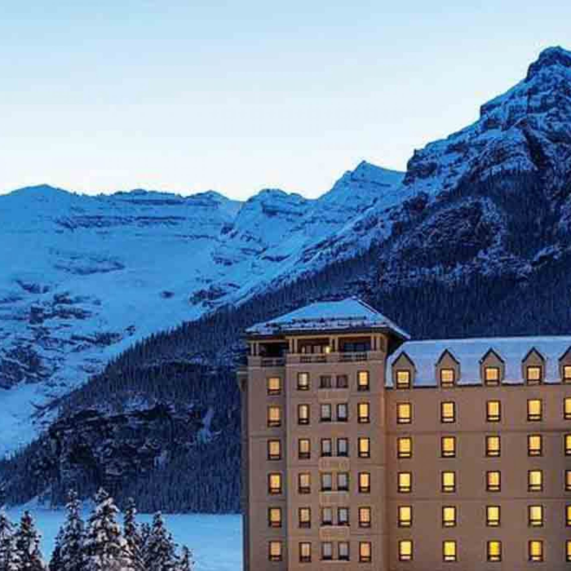 Fairmont Chateau Lake Louise at night with Victoria Glacier behind