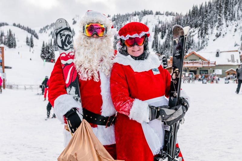 Santa and Mrs. Claus with their skis at Banff Sunshine Village, Banff National Park.