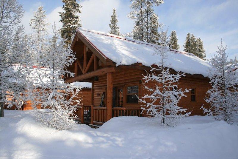 Exterior winter shot of cabin at Baker Creek Mountain Resort, Banff National Park.