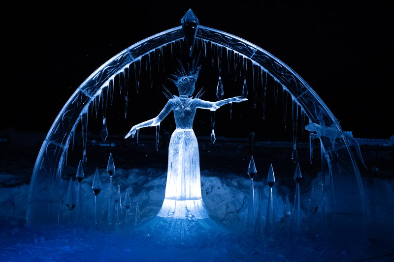 Night photo of ice sculpture at Ice Magic event in Lake Louise, Alberta, Canada.