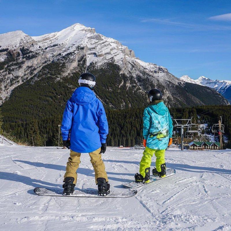 Kids snowboarding at Mt. Norquay, Banff National Park.