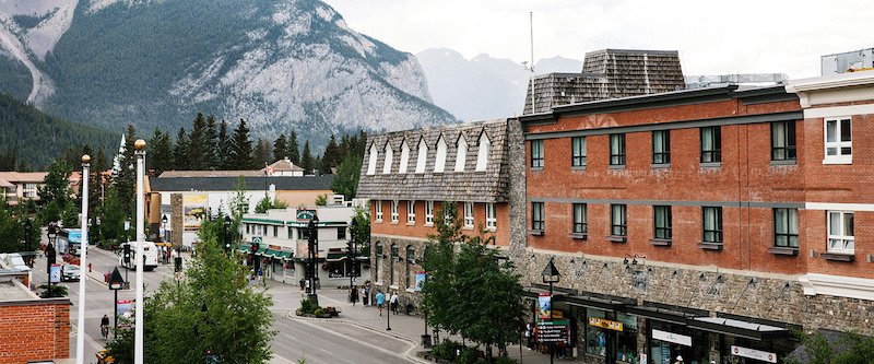 Banff Avenue view of Mt. Royal Hotel in summer, Banff National Park.