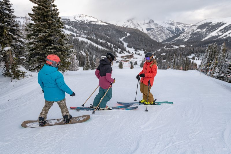 Friends skiing and riding together at Banff Sunshine Village, Banff National Park.