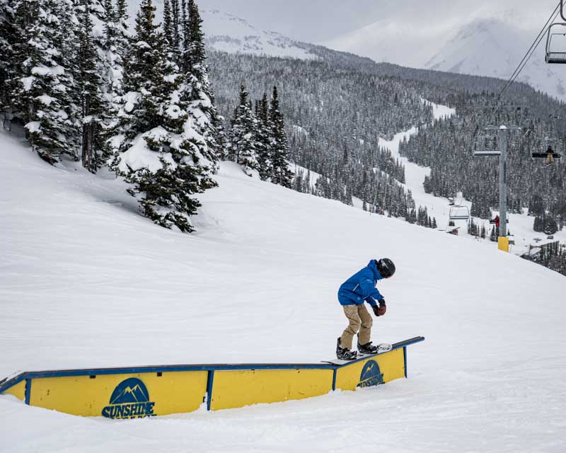 Boy riding rail at Banff Sunshine Village, Banff National Park.