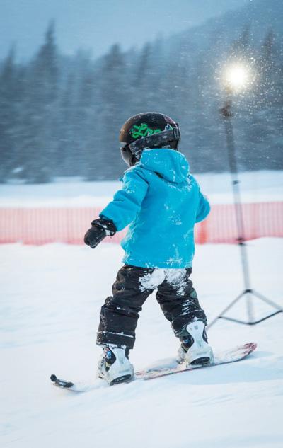 Boy on snowboard at Mt. Norquay, Banff National Park.