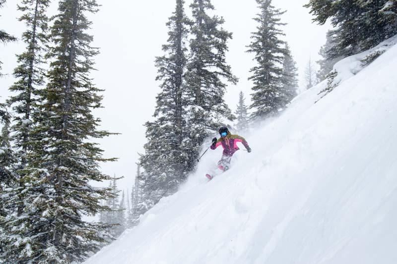 Skier on Tower 12 run at Lake Louise Ski Resort.