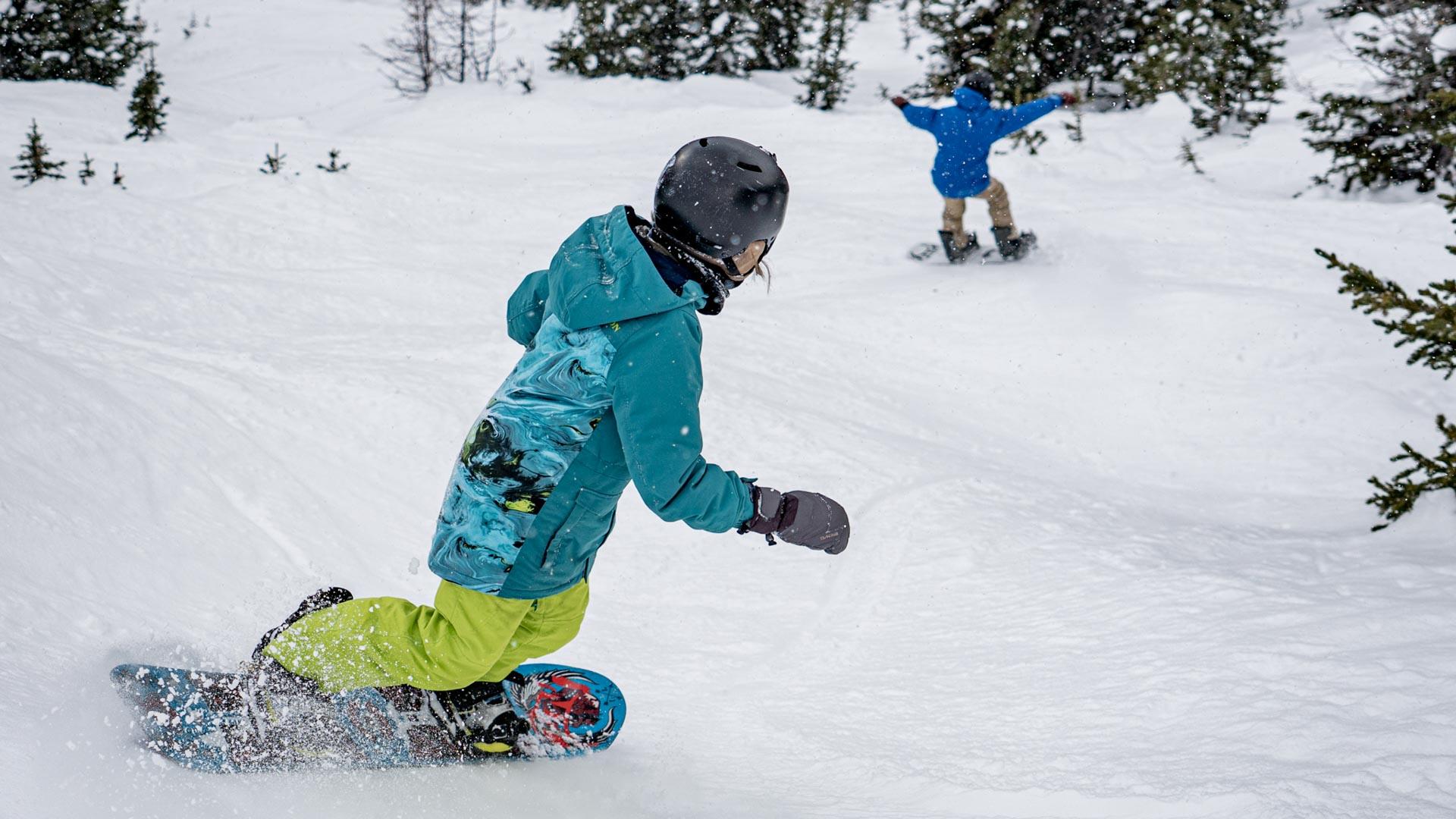 Boys snowboarding at Banff Sunshine Village, Banff National Park.